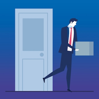 Homme d'affaires au chômage triste et boîte avec des objets