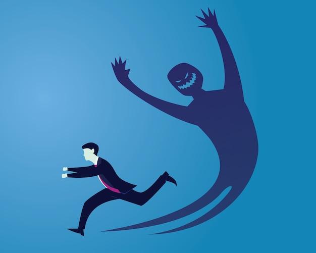 Homme d'affaires ayant peur de sa propre ombre