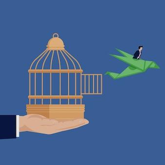 Homme d'affaires en cage à oiseaux avec oiseau origami dollar.