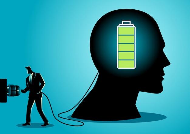 Homme d'affaires chargeant un cerveau