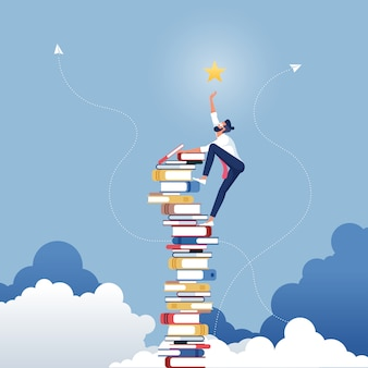 Homme d'affaires cherche les étoiles en utilisant des livres comme plate-forme