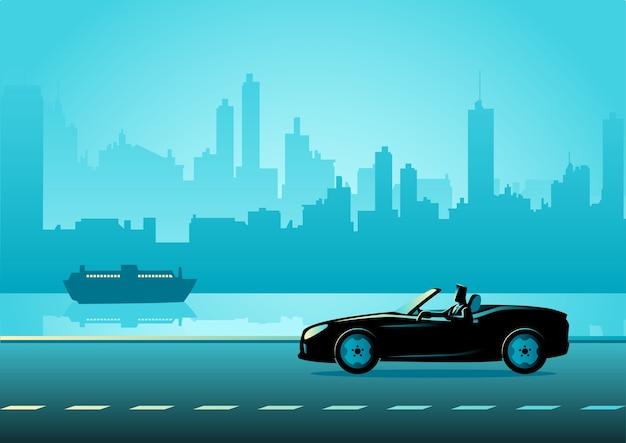 Homme d'affaires conduisant une voiture de luxe convertible
