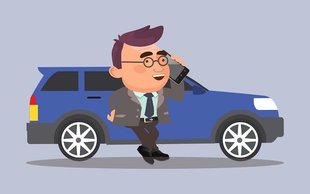 Homme d'affaires debout près de la voiture et parlant par téléphone portable