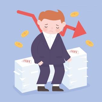 Homme d'affaires déprimé assis sur les dettes