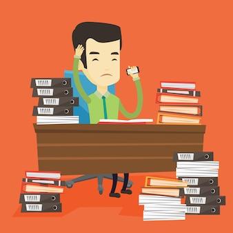 Homme d'affaires désespéré travaillant au bureau.