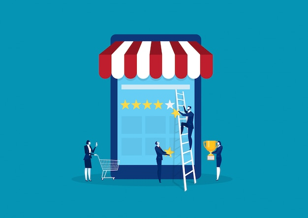 Homme d'affaires détenant une étoile d'or à la main, pour en donner cinq. sur le shopping en ligne smartphone.