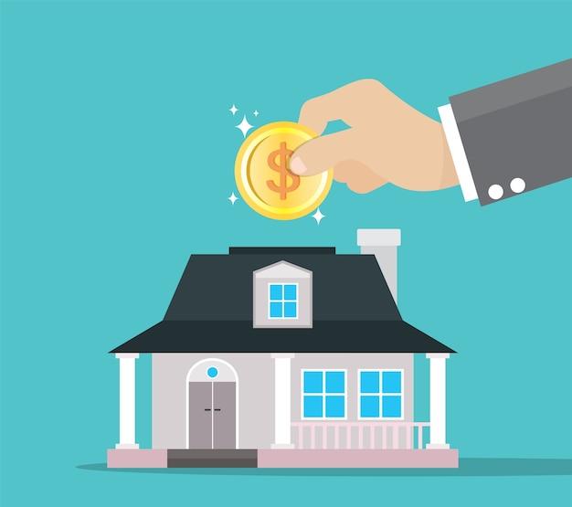 Homme d'affaires économiser de l'argent pour acheter une maison.