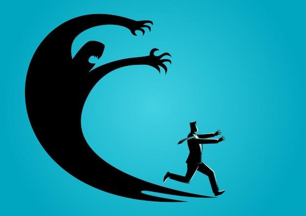 Homme d'affaires effrayé avec sa propre ombre