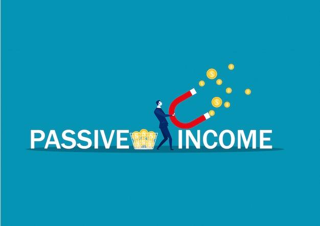 Homme d'affaires essaie d'attirer de l'argent avec le mot revenu passif aimant