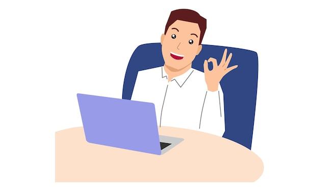 Homme d'affaires est assis sur le lieu de travail au bureau