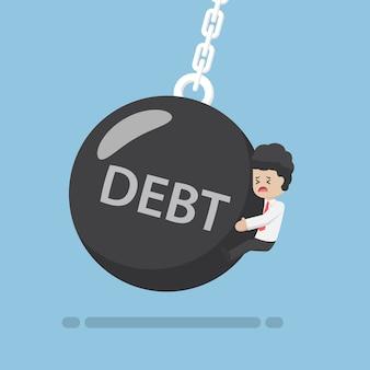 Homme d'affaires est touché par la boule de démolition de la dette