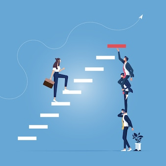 Homme d'affaires et femme d'affaires construisant des étapes en équipe