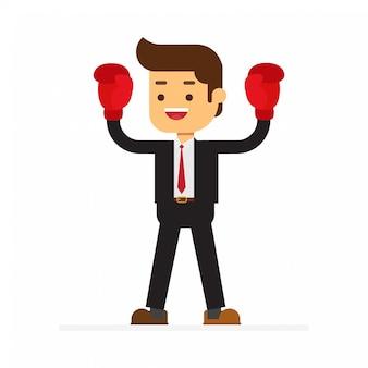 Homme d'affaires avec des gants de boxe est le gagnant