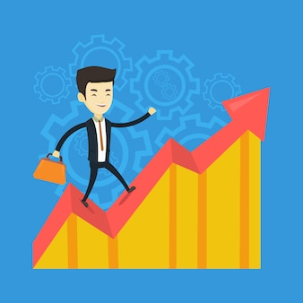 Homme d'affaires heureux debout sur le graphique des bénéfices.