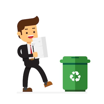 Homme d'affaires jette des documents papier dans une poubelle