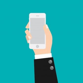 Homme d'affaires main tenant un téléphone intelligent mobile.