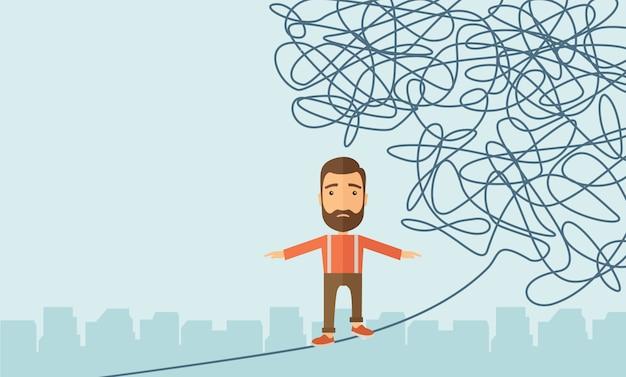 Homme d'affaires marchant sur une corde en danger.