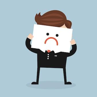 L'homme d'affaires a une mauvaise humeur.
