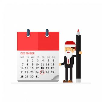Homme d'affaires de noël avec stylo et calendrier