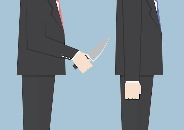 Homme d'affaires poignardant son ami dans le dos