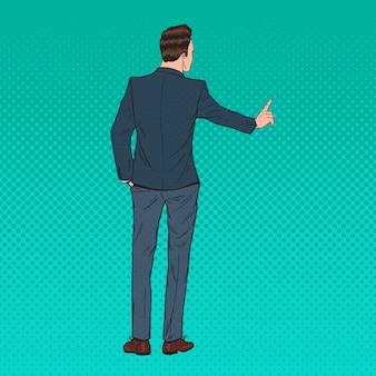 Homme d'affaires de pop art en appuyant sur un bouton imaginaire virtuel