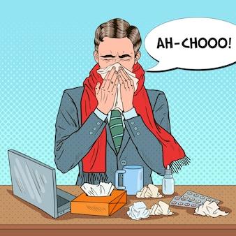 Homme d'affaires pop art éternuant au travail de bureau. homme avec des tissus