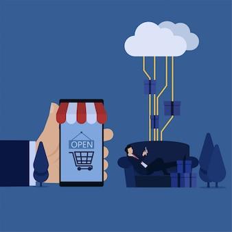 Homme affaires, poser, sofa, tenir téléphone, et, main, tenir, marché téléphone