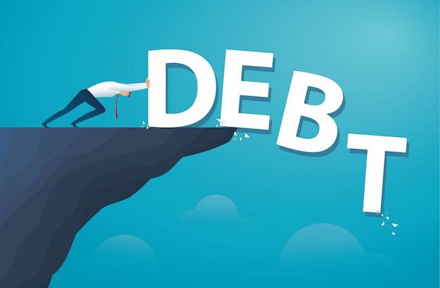 Homme d'affaires pousser la dette de mot. la liberté financière.