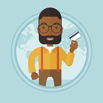 Homme d'affaires prospère détenant une carte de crédit