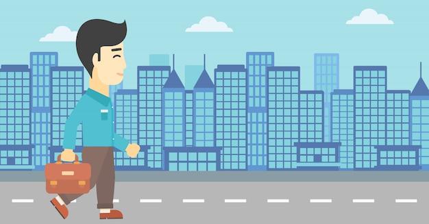 Homme d'affaires prospère à pied avec mallette.