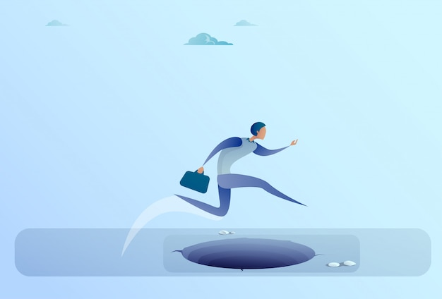 Homme d'affaires sauter par-dessus l'écart du concept de risque pour le succès commercial