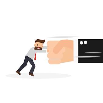 Homme d'affaires se battant avec une grosse main