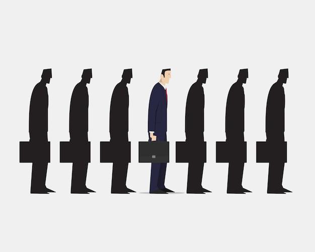 Homme d'affaires se démarquant de la foule du groupe de boursiers noirs identiques sur fond blanc.