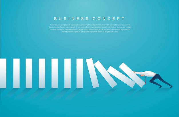 Homme d'affaires stoppant l'effet domino