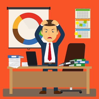 Homme d'affaires stressé au travail.