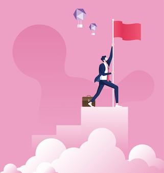 Homme d'affaires tenant un drapeau au sommet du graphique à colonnes