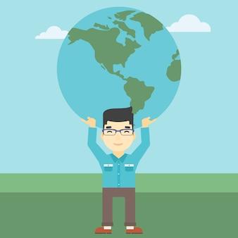 Homme d'affaires tenant le globe terrestre.