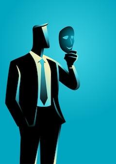 Homme d'affaires tenant un masque devant son visage