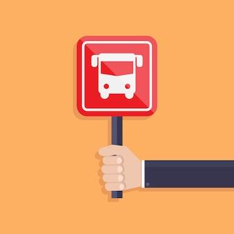 Homme d'affaires tenant un vecteur de signe de bus