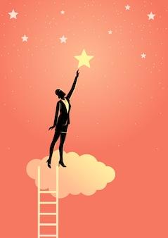 Homme d'affaires tendre la main vers l'étoile