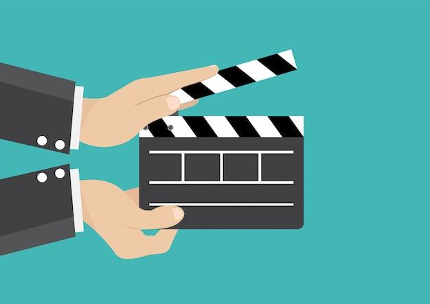 Homme affaires, tenue, film, clap, conseil, cinéma