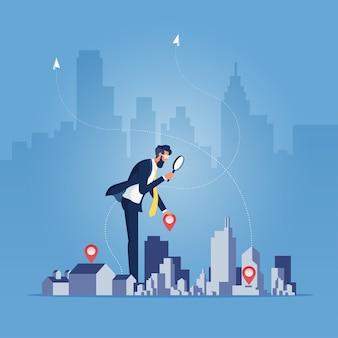Homme affaires, tenue, loupe, et, bâtiment, sélection bâtiment