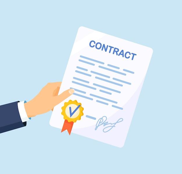 L'homme d'affaires tient et signe le papier du contrat commercial. signature de l'accord