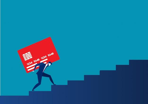 Homme d'affaires transportant un lourd concept de dette financière de carte de crédit