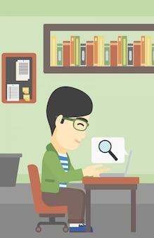 Homme d'affaires travaillant sur son ordinateur portable.