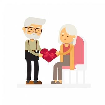 Un homme âgé faisant cadeau à une femme âgée