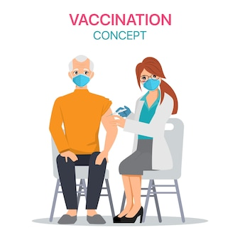 Un homme âgé reçoit le vaccin covid-19 à l'hôpital.