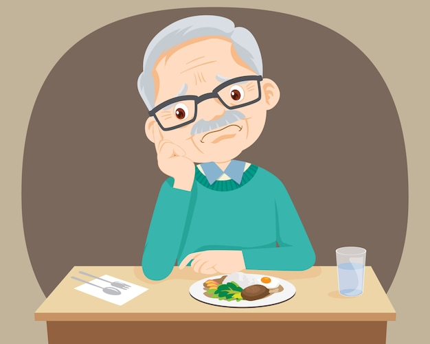 Un homme âgé s'ennuie avec de la nourriture