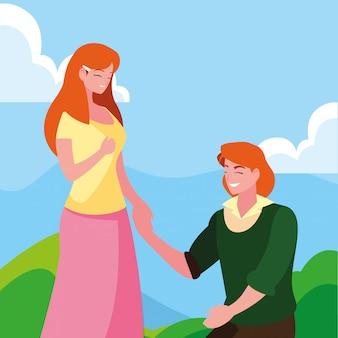 Homme agenouillé avec femme tenant la main