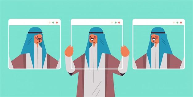 Homme arabe tenant les fenêtres du navigateur web avec différents masques guy couvrant les émotions du visage faux sentiment dépression trouble mental concept portrait illustration horizontale